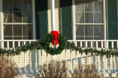 Garlands (whether made of natural or artificial material) are an easy way to decorate for a holiday in an eye-catching way. Are you concerned about how you're going to attach your garland to your home? Peruse these tips: http://landscaping.about.com/od/winterlandscaping/f/hanging-garlands.htm