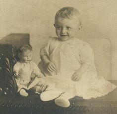 Baby with old doll from the 1900's