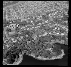 Wanganui, view of Sacred Heart Convent (now Jane Winstone Retirement Home) and Virginia Lake, Saint Johns Hill and Great North Road looking towards the city and river beyond - Date: 6 Apr 1955