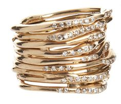 Individual free form gold bands and white diamonds set without prongs... Don't let jack tell you to use prongs. I would want lots of them to stack together. Would be cool with a long large stone set on what would appear to be 2 or 3 of the bands, that would allow me to stack individual bands on both sides to make a larger band if I wanted.