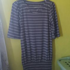 Striped Mini Dress White stripes on top of a greyish color. Conservative on the top then short and tight on the bottom. The sleeves are elbow length and flowy. Very comfy and worn maybe once, so in great condition!   No trades but willing to negotiate!! Poof! Dresses Mini