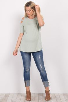 A solid short sleeve maternity top. Cutout shoulder. Rounded neckline. This style was created to be worn before, during, and after pregnancy.
