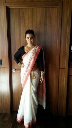 Kajol in a white saree or sari and black blouse