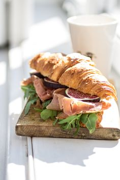 croissant with serrano ham, figs and olive tapenade