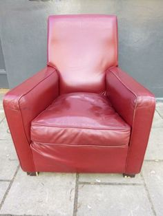 Red vintage high back leather arm chair. Previously removed from a cinema. For sale on SalvoWEB from Architectural Forum in London [Salvo code dealer
