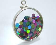 Shake Locket Collection - Fireworks Glitter Glass Double Sided Holiday Sterling Silver Filled Firework Glitter Holographic Necklace. $59.00, via Etsy.