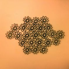 Toilet paper roll art! Hot glue 1 inch pieces together and spray paint black!