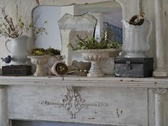 Great mixture of urns, ironstone pitchers on old mantle.