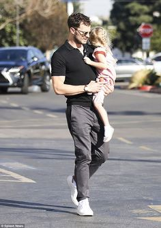Daddy-daughter time: Jamie Dornan, 35, looked every inch the caring father in Los Angeles as he stepped out with his eldest daughter Dulcie for ice cream on Saturday