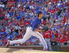 Texas Rangers starting pitcher Cole Hamels (35) throws a ninth-inning pitch in his complete game win during the Los Angeles Angels vs. the Texas Rangers major league baseball game at Globe Life Park in Arlington on Sunday, October 4, 2015. (Louis DeLuca/The Dallas Morning News)