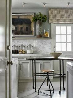 like this curtain mounted high over the door, over the sink in our case- and the mantel/ counter set up