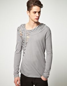 Delusion: Writhe L/S Top  Long sleeve top by Delusion. Constructed in a pure cotton jersey. Featuring a draped neck with a lattice strap design to the side, a hood and dipped hem to the reverse. Designed in a regular fit.
