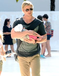 Chris Hemsworth cradling his baby daughter
