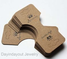 Fold Over Necklace Bracelet Ponytail Holder Earrings Hanging Card(with Logo)..100pcs. $7.50, via Etsy.