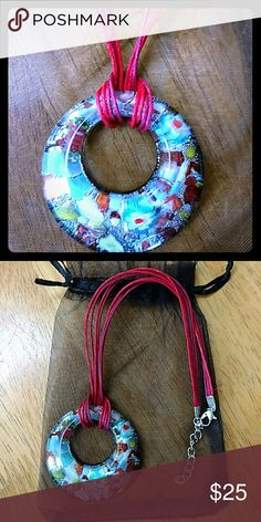 Gourgous blown glass bead, colors with in colors This bead was blown glass by a friend, he filled it with blues, reds, and layers of color.  This bead is a work of art itself.  It is on a multi strand red cord.  The bread can easily be changed between different cords for different lengths and looks.  * Artisan crafted *Ready to ship Jewelry Necklaces