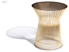 Year in Review: 70 Must-See Furnishings   Wheel side tables in bronze with Platner side table with bronze-painted steel base and tempered-glass top by Knoll. #design #interiordesign #interiordesignmagazine @knolldesign
