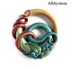 Pendant by Alkhymeia Stunning colors and curves in metallic pollymer clay gorgeous!