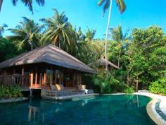 Escape to top vacation spot Soneva Resort & Spa, Kunfunadhoo Island, Maldives.  Deserted island-chic is in big supply on Kunfunadhoo Island's Soneva Fushi Resort. Wander the days away sans shoes in the lushly tropical resort and surrounding jungle paths before returning to a pool experience that indulges all your senses. Is there any place else you'd rather be stranded?