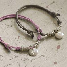 Charmed leather bracelet