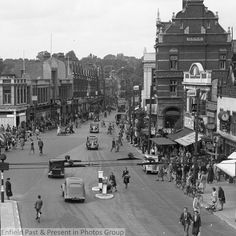 Enfield Town looking West. Based on the cars and people I'd guess early Enfield England, Enfield Middlesex, Enfield Town, Vintage London, North London, Local History, Family Memories, Vintage Photographs, Old Pictures