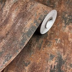 Industrial Loft Wall wallpaper in copper 326511. Easily create a modern industrial feel to any room with this multi tonal charcoal and copper design with a light catching metallic sheen.