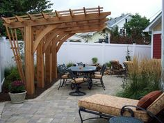 Cantilevered pergola - we like this design the best, although not stuck on curved beam supports.  Straight is fine.