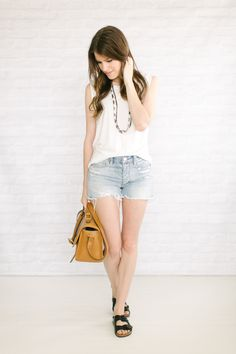 Capsule #3 / Outfit 21  Never underestimate the power of a white shirt. Or in this case, a white muscle tank. I think this plain-ish look is cool + chic -- perfect for being out and about on a hot...