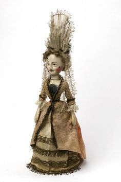 Doll (England) ca. 1680 Wood, gessoed and painted, leather, and satin trimmed with metallic lace and fringe