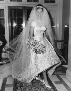 Actress and author Jackie Collins celebrates her marriage to businessman Austin Wallace at Grosvenor House in London after a registry office ceremony. Her white satin wedding dress with intricate. Get premium, high resolution news photos at Getty Images Famous Wedding Dresses, Celebrity Wedding Dresses, Celebrity Weddings, Wedding Gowns, 1960s Wedding Dresses, Jackie Collins, Vintage Wedding Photos, Vintage Bridal, Vintage Weddings