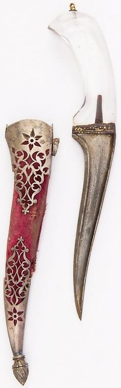 Indian pesh kabz dagger, 18th to 19th century, wootz steel blade, silver, crystal, velvet, wood, gold, H. with sheath 9 3/8 in. (23.8 cm); H. without sheath 7 3/4 in. (19.7 cm); H. of blade 4 3/4 in. (12.1 cm); W. 1 3/4 in. (4.5 cm); Wt. 2.2 oz. (62.4 g); Wt. of sheath 1.7 oz. (48.2 g), Met Museum, Bequest of George C. Stone, 1935.