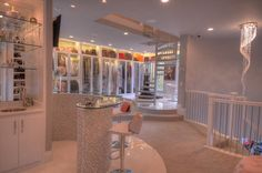 No, this is not an exclusive boutique - it is the 3-story Master Wardrobe closet in a mansion in The Woodlands, Texas. This is the 2nd floor...