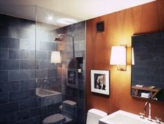colours: blue slate tile and teak-stained warm wood