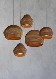 Lampshades made of cardboard and beech plywood.