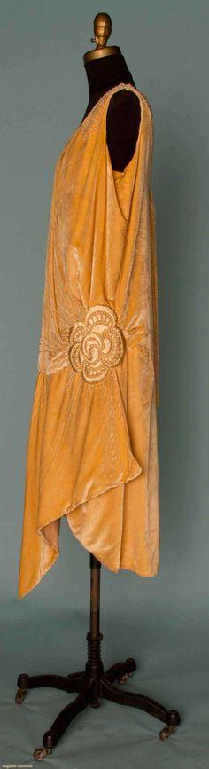 BEADED VELVET FLAPPER DRESS, MID 1920s Faun silk velvet, large Deco rose embroidered over left hip in silk floss & pearl beads, pearl bands descend from shoulder to low back neckline. Sideway