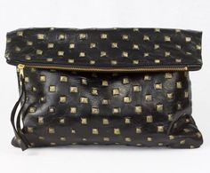 Oversized leather clutch with embossed faux gold studs www.mooreaseal.com
