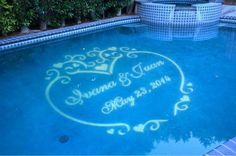 A gobo in a swimming pool makes an elegant statement for outdoor wedding lighting. www.stagelabs.com