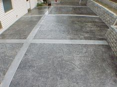 Stamped Concrete by design is one of the most versatile and colorful design options when it comes to creating a patio, walkway or driveway. Stamped concrete allows for the addition of integral color that gets blended into the mix during the placement of the cement as well can have a variety of surface colors as well as patterns added to the finish.