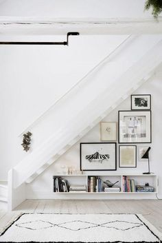 Nice use of Art in space under stairs! Domino magazine shares storage tips for the space under the stairs. How to decorate the empty space under the stairs. Style At Home, Home Deco, Space Under Stairs, Open Stairs, White Stairs, Under The Stairs, Floating Stairs, Floating Shelves, Escalier Design