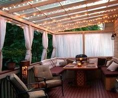 Backyard Ideas / deck..you can even use shower curtains in place of the curtains to keep out the rain:)
