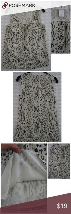 """Ann Taylor Loft Animal Print Blouse tank SZ XS Size: XS Brand: Ann Taylor LOFT Style: Animal Print / Tiger / Black and White and Grey Notes: Fully lined (see photos), Scoop Neckline, Great Used Condition with no rips, tears, or smells. Material: 100% polyester  Approximate Measurements while garment is laying flat: armpit to armpit and doubled: 30-32"""" Length (measured at back of neckline to bottom of shirt) - 25"""" Ann Taylor Tops Blouses"""