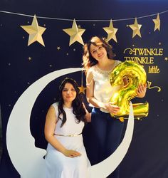 Moon PhotoBooth ; Cute photo idea...navy blue sheet background with stars, a bench to sit on, a big white moon made of styrofoam ; moon and star photo prop ; Gold + Glitter + Star themed birthday party ; twinkle twinkle little start party theme ; Paper Star Garland ;