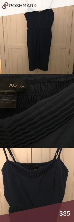 NEW! AQUA Dress Dark blue AQUA sweetheart v neck flare skirt dress. Dress has adjustable straps and an elastic section in the back to accommodate various bust sizes. There is also elastic at the hips/waist to allow flare in the skirt. Dress is size M and 100% polyester. Free of any rips, tears or stains. Aqua Dresses Mini