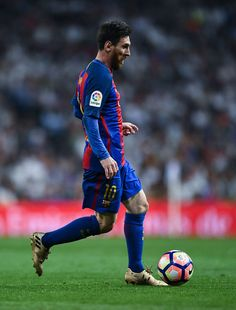Lionel Messi of FC Barcelona runs with the ball during the La Liga match between Real Madrid CF and FC Barcelona at the Santiago Bernabeu stadium on April 23, 2017 in Madrid, Spain.