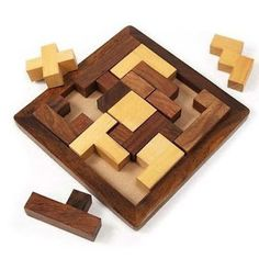 "Handmade ""Piece It Together"" Wood Puzzle Handmade and Fair Trade. This handmade puzzle features different-shaped wooden pieces and square frame base. Woodworking For Kids, Woodworking Toys, Popular Woodworking, Woodworking Furniture, Woodworking Projects, Youtube Woodworking, Woodworking Machinery, Handmade Home, Handmade Wooden"
