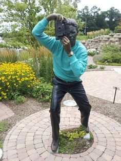 Bronze camera guy at Nicholas Conservatory and Garden in Rockford, Illinois.