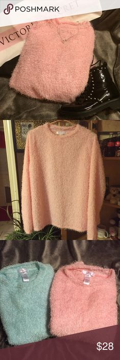 Plus sizes lightweight sweaters This sweater is such a beautiful pink color. Very lightweight so perfect for any Season. Very soft and fluffy. I have 2 available in pink size 1X and 2X. Blue color sweater on separate listing, exact same sweater. New with tags, from non smoking home. Jessica Neomi Sweaters