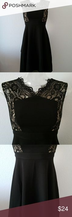 """Black dress with beautiful lace top Black A line dress with a beautiful lace top with nude lining.  I really love the way the lace looks. Only worn twice and only has a bit of lint on the lace where my arms rubbed.  This dress should be about knee length for most. Measurements   Bust 16"""", waist 26"""", length 36.25"""" London Style Dresses Mini"""