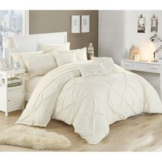 Looking for that perfect comforter set that has it all?? Elegant pinch pleat design, stunning decorative pillows and yes sheets included? Your search is over.. This gorgeous elegant white pleated pinch pleat look is very elegant, simple and sophisticated way to enhance any bedroom. Beautiful decor pillows to match with sequence beads to match and a matching super-soft coordinating color sheets set.