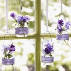 Reuse baby food jars... Put small fresh flowers and hang in a window!