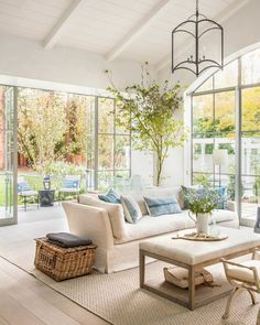 Whimsical living room design with french doors and white panneled ceilings | Giannetti Atherton